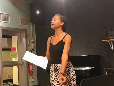 Erica Moore (Queen) rehearses.